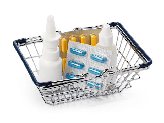 Médical, bouteille blanche et pilules dans le panier