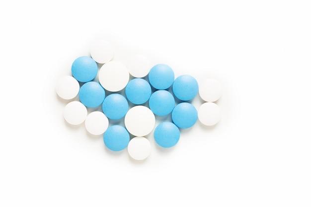 Médicaments de pilules bleu et blanc de concept de santé et de drogue