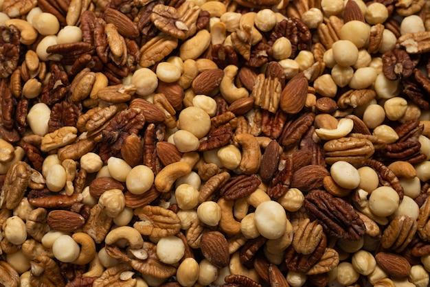 Mélange de noix en arrière-plan. vue de dessus.