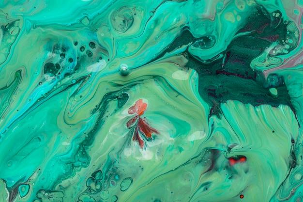 Mélange de texture artistique de peinture acrylique verte et bleue
