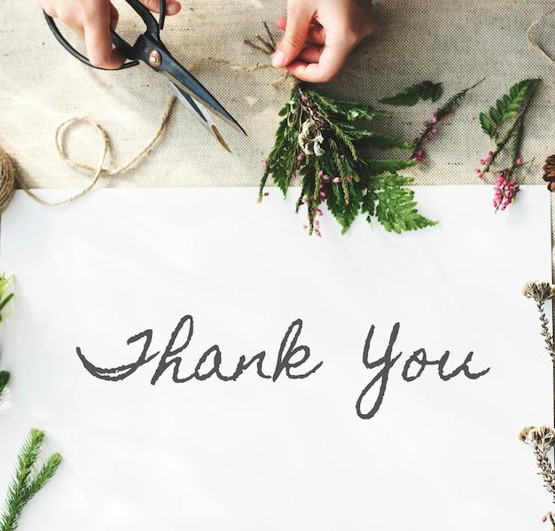Merci mot avec décoration à plat