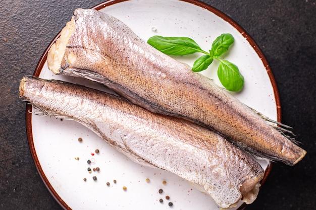 Merlu poisson cru filet blanc fruits de mer frais prêt à manger collation repas sur la table copie espace nourriture