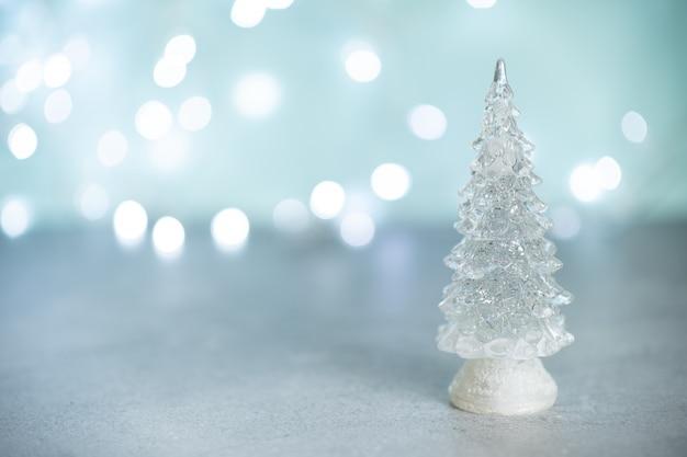 Message de joyeux noël avec arbre de noël dans un bocal en verre