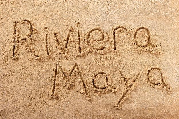 Message manuscrit sur la plage de sable de riviera maya