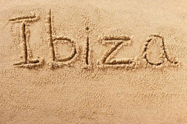 Message manuscrit de sable de plage à ibiza espagne