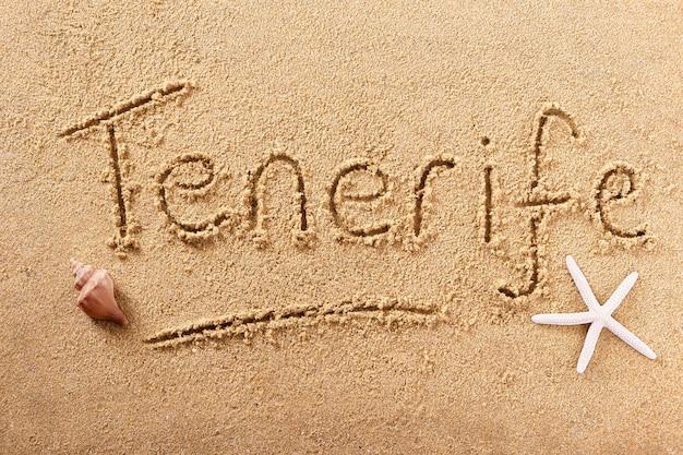 Message manuscrit de sable de plage de tenerife