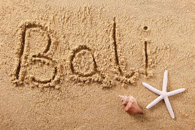 Message de sable de plage manuscrite de bali