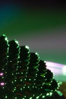 Métal liquide ferromagnétique vert avec espace de copie