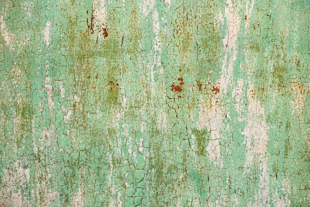 Métal orange vert et rouge abstrait ancien texturé