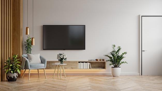 Meuble tv maquette dans un salon moderne avec fauteuil bleu et plante sur fond de mur blanc, rendu 3d