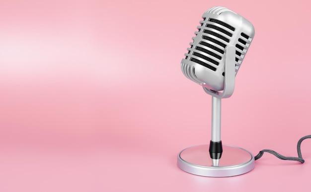 Microphone rétro avec espace copie sur fond rose