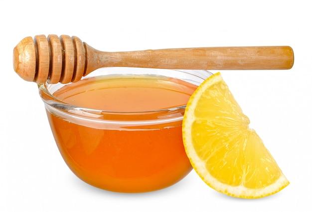 Miel citron isolé sur blanc avec un tracé de détourage
