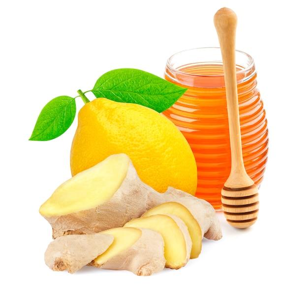 Miel, gingembre et citron isolé sur blanc