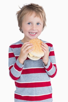 Mignon, heureux, jeune garçon, tenue, burger