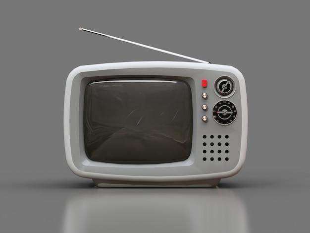 Mignon vieux téléviseur blanc avec antenne sur fond gris