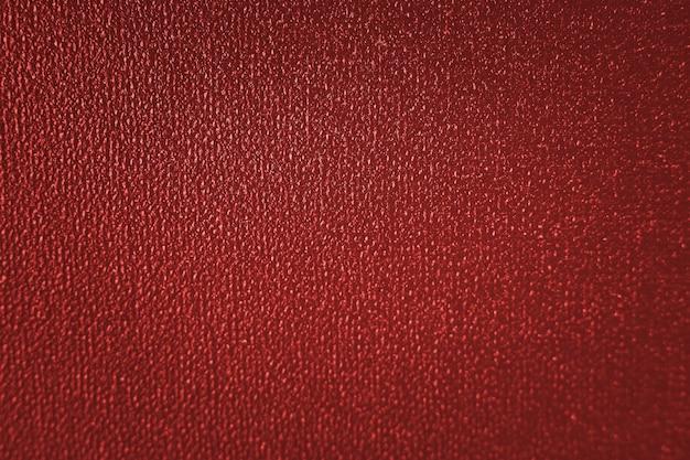 Mise au point sélective abstrait rouge. fond classique rouge avec vignette sombre. fond rouge de noël.
