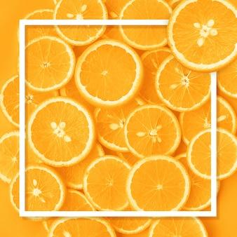 Mise à plat du motif de fruits orange avec cadre