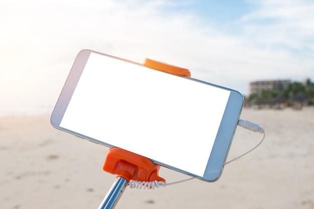 Mock up bâton de selfie extensible ou pod mono avec photo de prise de téléphone portable