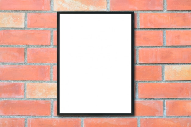Mock up blank picture frame on brick wall.