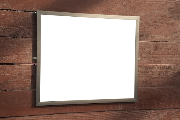 Mock up blank picture picture frame on wooden wall.
