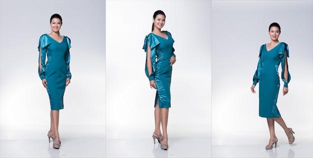 Mode jeune femme asiatique mince peau bronzée yeux cheveux bruns beau maquillage mode robe émeraude bleue posant un look humide glam attrayant. studio lighting blanc cassé fond gris, pack de groupe de collage