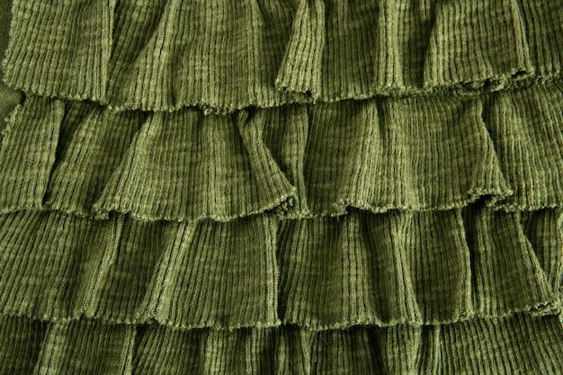 Mode tissu jupe plissée en gros plan vert
