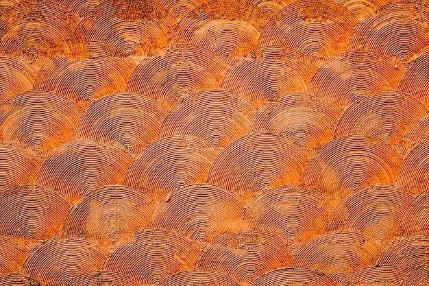Modèle d'art orange en béton sur la surface du mur. utiliser pour décorer et l'intérieur