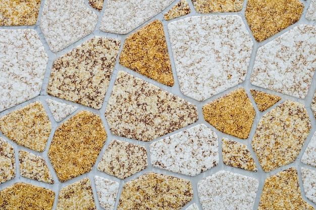Modèle de brique de surface agrandi au mur de briques en pierre texturé
