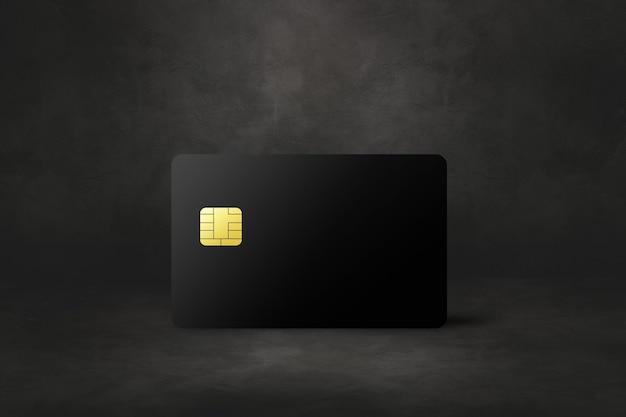 Modèle de carte de crédit noir sur fond de béton foncé. illustration 3d