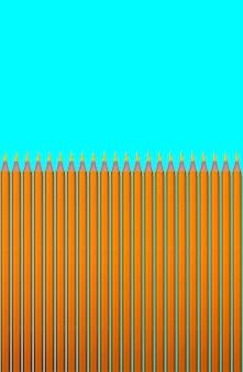 Modèle de crayons jaunes sur fond turquoise