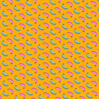 Modèle créatif d'extincteurs de bananes colorées sur fond orange vif.