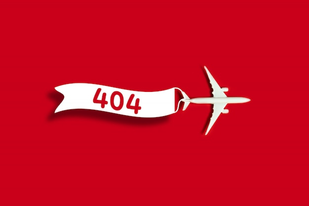 Le modèle indique que la page est introuvable avec un modèle d'avion jouet et un ruban