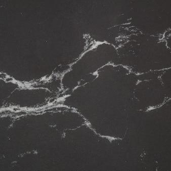 Modèle de marbre surface agrandi à l'arrière-plan de la texture de mur en pierre de marbre noir