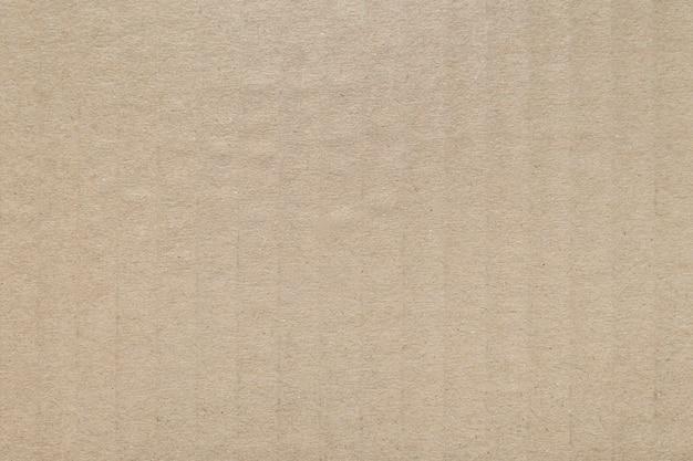 Modèle de papier carton brun et texture pour le fond.