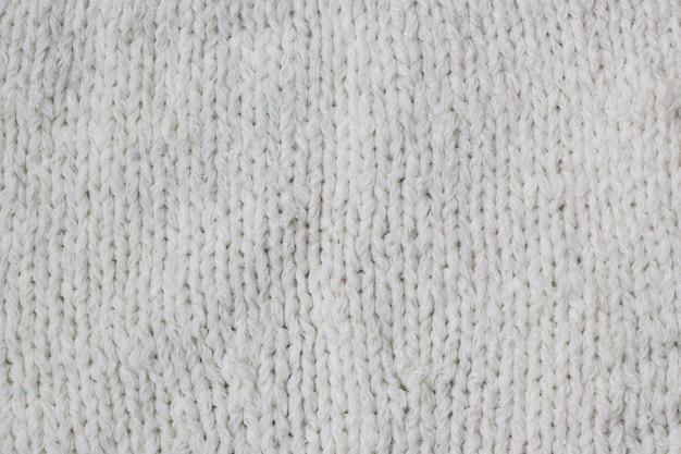Modèle de pull ou écharpe de fond de texture de tissu tricoté blanc