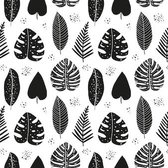 Modèle sans couture abstrait dessiné à la main avec des feuilles tropicales