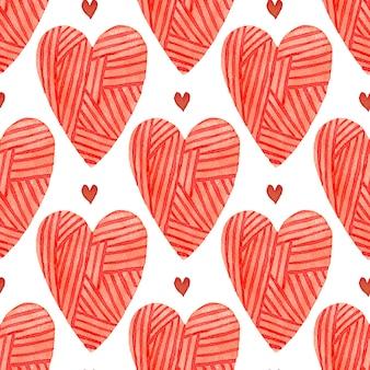 Modèle sans couture aquarelle coeurs rouges. toile de fond romantique peinte