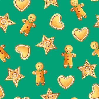 Modèle sans couture aquarelle de noël avec bonhomme en pain d'épice, étoile, biscuits coeur sur vert