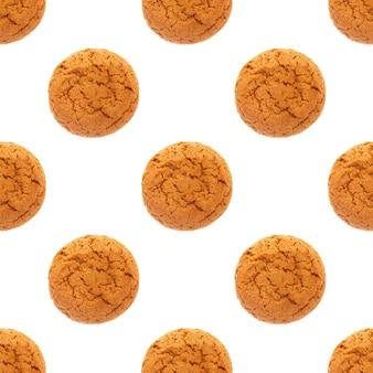 Modèle sans couture de biscuits à l'avoine isolé sur fond blanc. photo de haute qualité