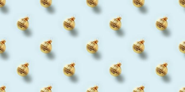 Modèle sans couture de boules dorées sur bleu