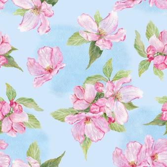 Modèle sans couture avec brunch aux pommes en fleurs sur bleu