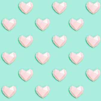 Modèle sans couture avec couleur rose coeur volumétrique