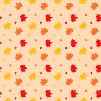 Modèle sans couture de feuilles d'érable colorées sur fond clair.