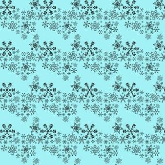 Modèle sans couture avec des flocons de neige sur fond bleu.