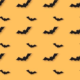 Modèle sans couture d'halloween avec fond orange et silhouette de chauve-souris.