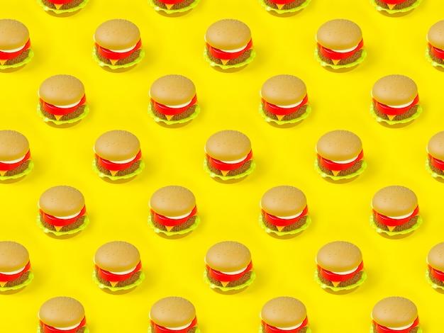 Modèle sans couture de hamburger en plastique sur fond jaune.