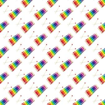 Modèle sans couture de jouet en bois de couleur arc-en-ciel glockenspiel xylophone 8 tons isolé sur blanc