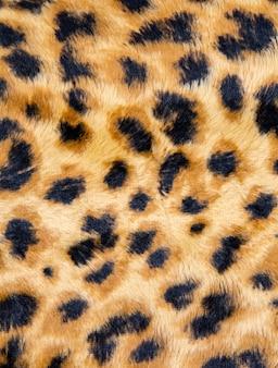 Modèle sans couture léopard à la mode. fond de peau de léopard tacheté stylisé