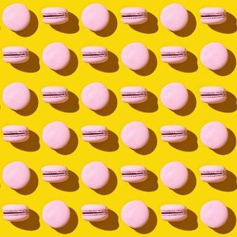 Modèle sans couture de macarons cookies français colorés