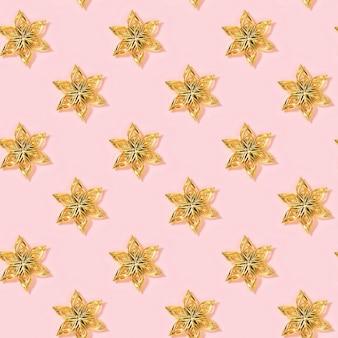 Modèle sans couture minimal de nouvel an avec fleur de jouets dorés ou étoile